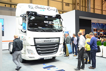 A large truck stand at The Commercial Vehicle Show - image