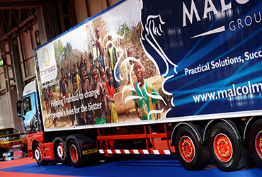 A large truck in one of the halls at The Commercial Vehicle Show - image